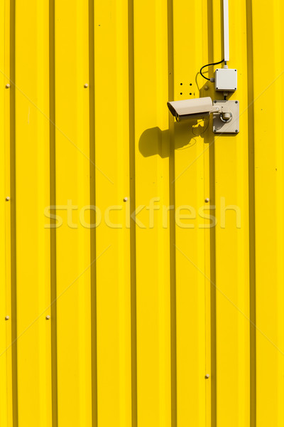 Security camera on a yellow wall Stock photo © lightpoet
