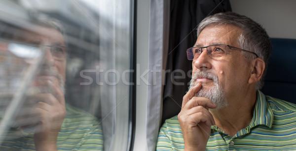 Senior homem trem viajar carro Foto stock © lightpoet