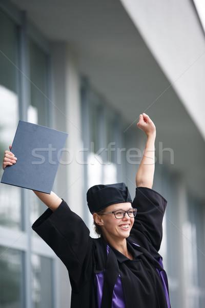 Pretty, young woman celebrating joyfully her graduation Stock photo © lightpoet