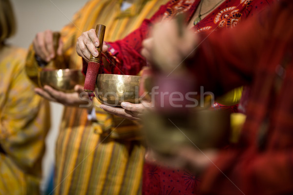 Man playing on a tibetian singing bowl Stock photo © lightpoet