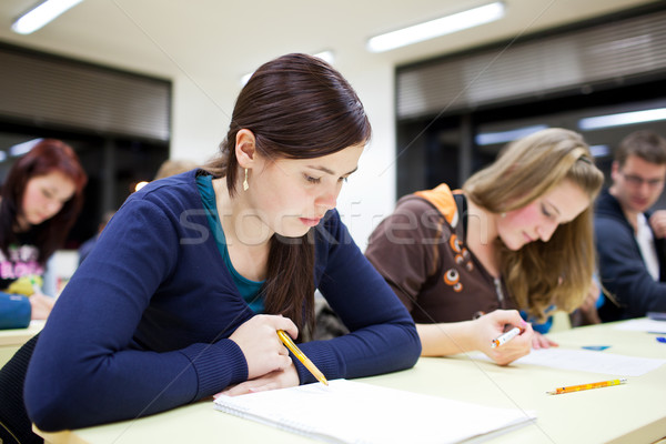 pretty female college student sitting in a classroom Stock photo © lightpoet