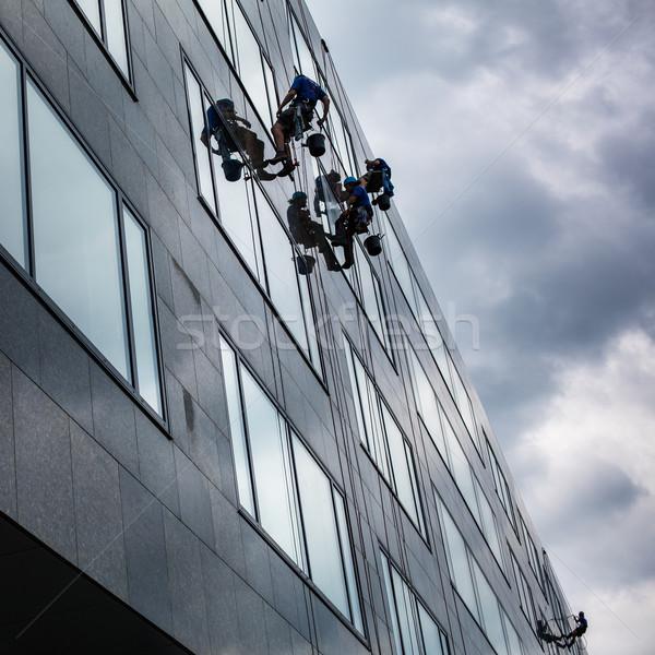 Climbers washing windows of a modern high-rise building  Stock photo © lightpoet