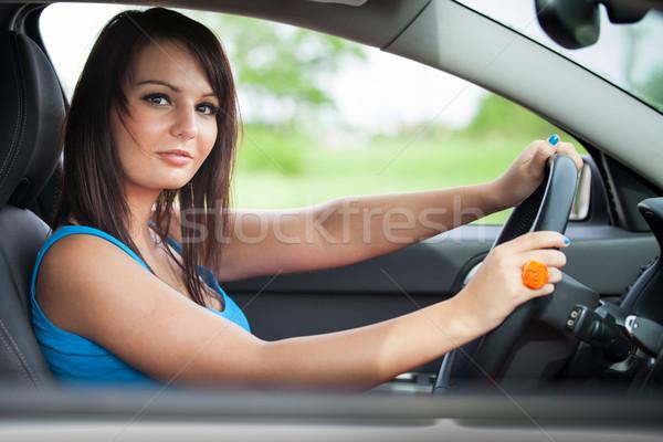 Dość młoda kobieta jazdy działalności drogowego Zdjęcia stock © lightpoet