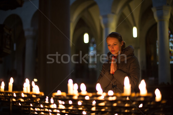 Young woman praying in a church Stock photo © lightpoet