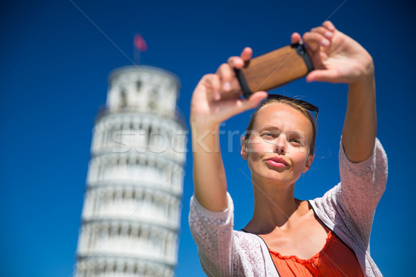 Gorgeous young woman taking a selfie with her smart phone  Stock photo © lightpoet