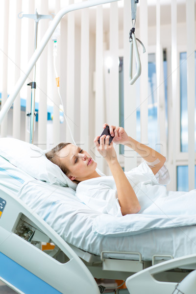 Pretty, young, female patient in a modern hospital room Stock photo © lightpoet