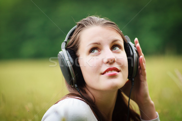 portrait of a pretty young woman listening to music Stock photo © lightpoet