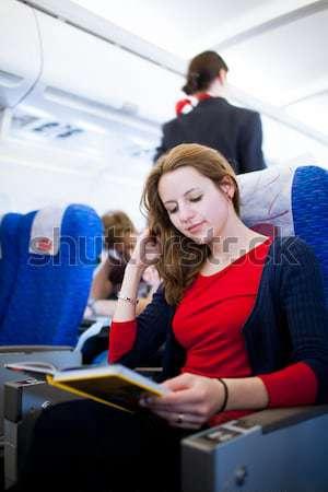 Csinos fiatal női tábla repülőgép szín Stock fotó © lightpoet