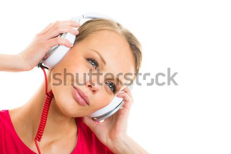 Pretty, young woman listening to her favorite music on hi-fi hea Stock photo © lightpoet