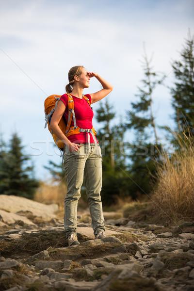 Pretty, female hiker going downhill in warm evening light Stock photo © lightpoet