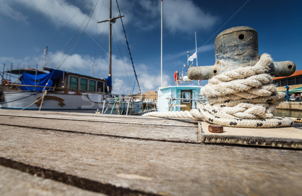 Boat docking point at a marina - rope fixed around a belay Stock photo © lightpoet