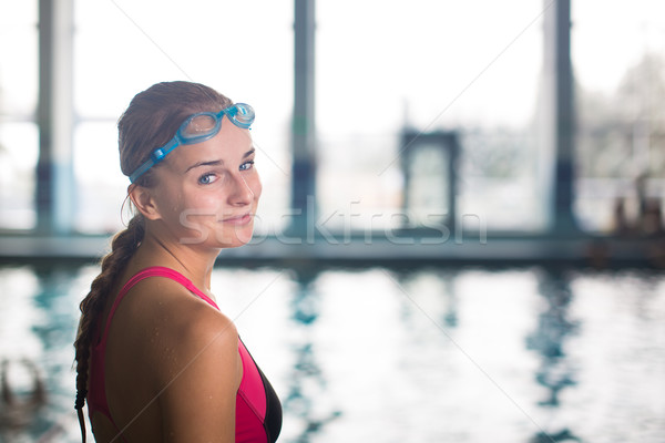 Female swimmer in an indoor swimming pool - going for her swim Stock photo © lightpoet