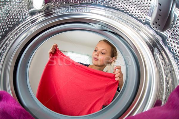 Ménage jeune femme buanderie peu profond couleur Photo stock © lightpoet