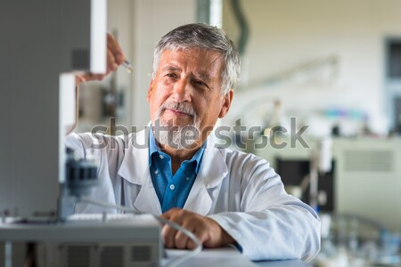 Senior chemistry professor/doctor in a lab (color toned image) Stock photo © lightpoet