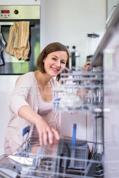 Fiatal nő modern konyha ház lány étel Stock fotó © lightpoet