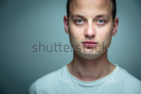 Portrait of a handsome young man, perfectly calm, facing the camera Stock photo © lightpoet