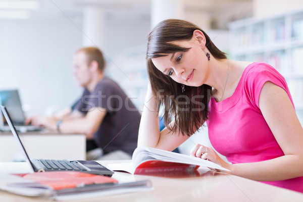 in the library - pretty female student with laptop Stock photo © lightpoet