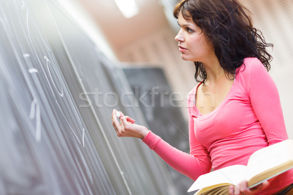 Pretty young teacher writing on the blackboard Stock photo © lightpoet