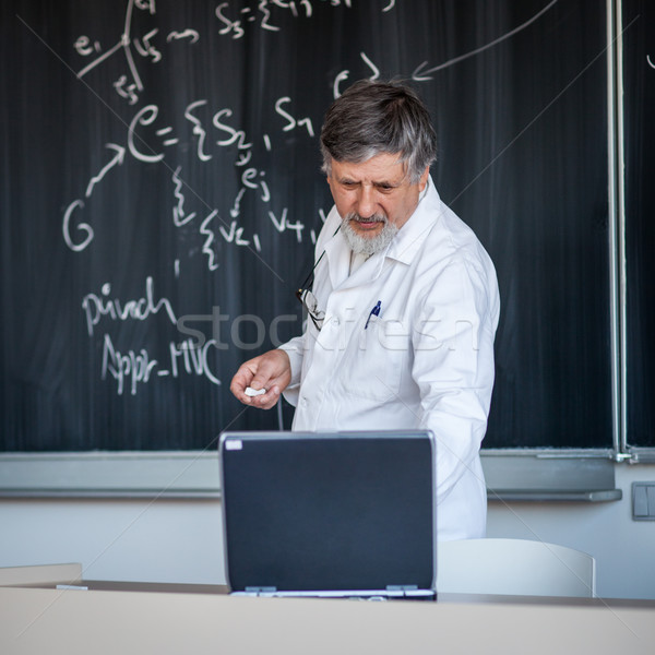 Senior chemistry professor writing on the board Stock photo © lightpoet