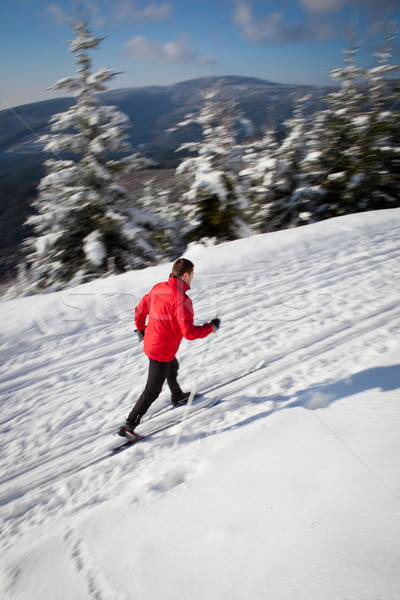 Cross-country skiing: young man cross-country skiing on a lovely Stock photo © lightpoet