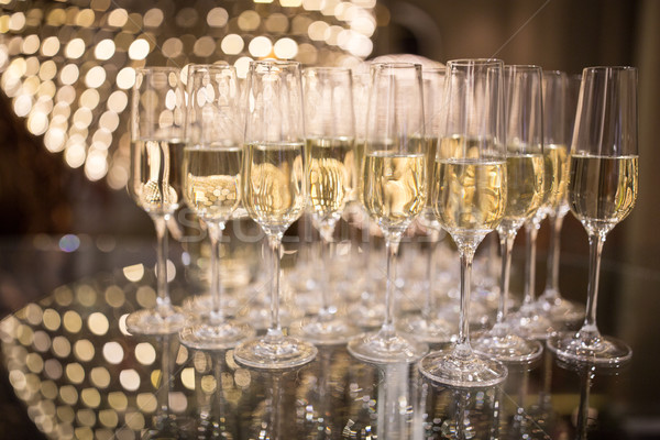 Champagne flutes on shiny, glassy background  Stock photo © lightpoet