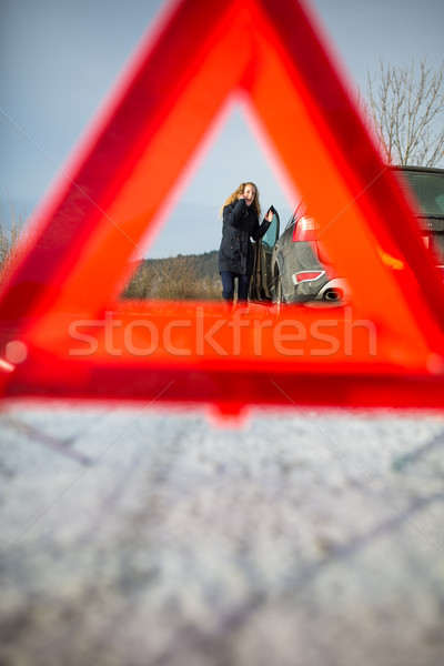 Realy angry young woman in a road distress situation - setting u Stock photo © lightpoet
