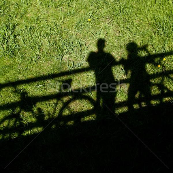 two mountain bikers' silhouettes during a halt on a bridge Stock photo © lightpoet