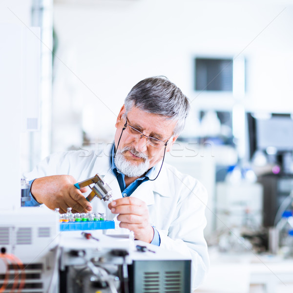 Stock photo: senior male researcher carrying out scientific research in a lab