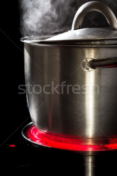 Slowfood - Lovely homemade dish being prepared in steaming pot o Stock photo © lightpoet