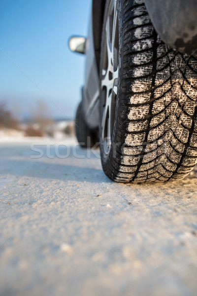 Car with winter tires on a slippery, snowy road Stock photo © lightpoet