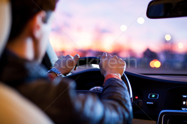 Stock photo: man driving his modern car at night in a city