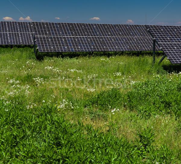 Sunlight as a resource of renewable energy: solar panels Stock photo © lightpoet