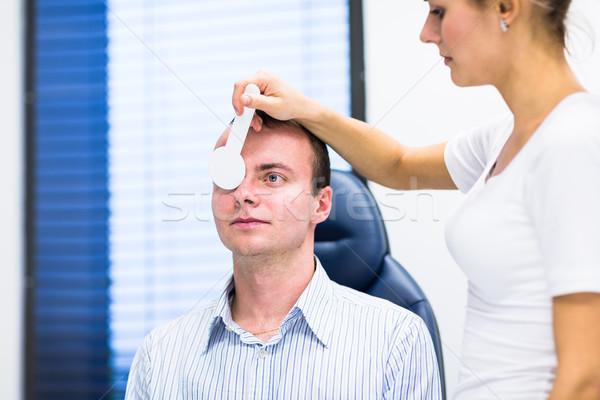 Młody człowiek oczy okulista przystojny kobieta człowiek Zdjęcia stock © lightpoet