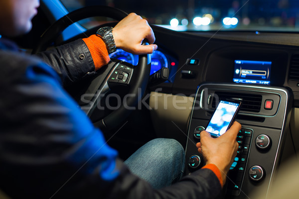Man driving his modern car at night in a  city Stock photo © lightpoet