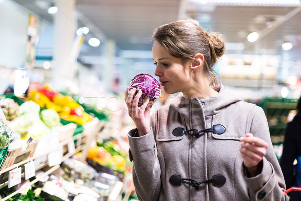 Pretty, young woman shopping for fruits and vegetables Stock photo © lightpoet