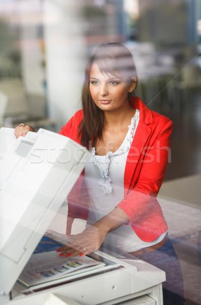 Pretty  female college student/secretary using a copy machine Stock photo © lightpoet