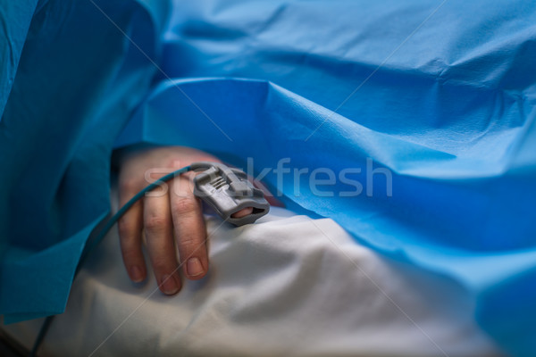 Detail of a hand of a patient being monitored dusing surgery - v Stock photo © lightpoet