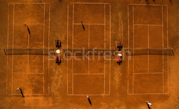 Aerial shot of a tennis courts with players in warm evening sunl Stock photo © lightpoet