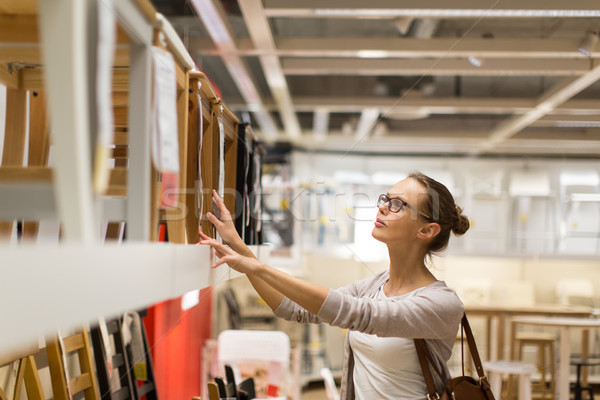 Pretty, young woman choosing the right furniture  Stock photo © lightpoet