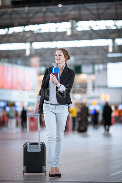 Pretty young female passenger at the airport Stock photo © lightpoet
