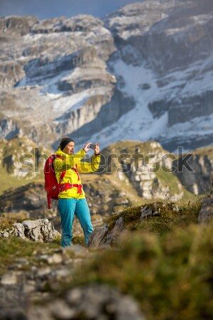 Stock photo: Pretty, young female hiker walking in high mountains