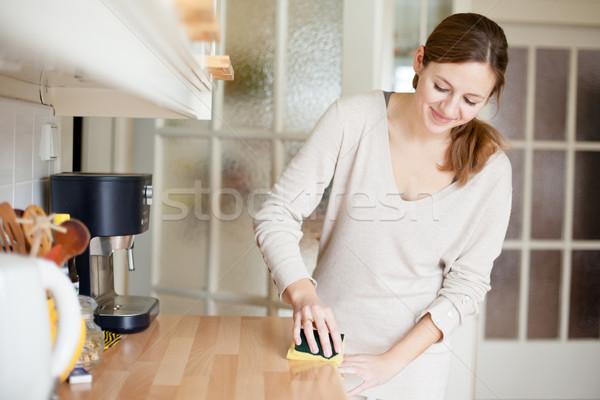Fiatal nő házimunka takarítás konyha ház lány Stock fotó © lightpoet