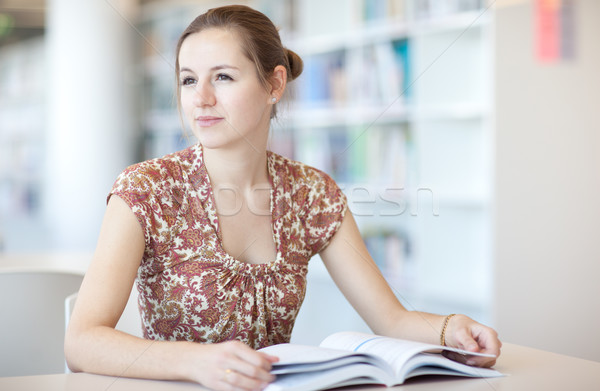 pretty young college student in a library (shallow DOF; color to Stock photo © lightpoet