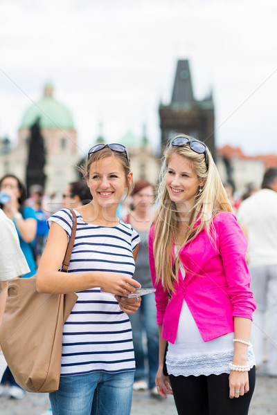 Two female tourists walking along the Charles Bridge Stock photo © lightpoet