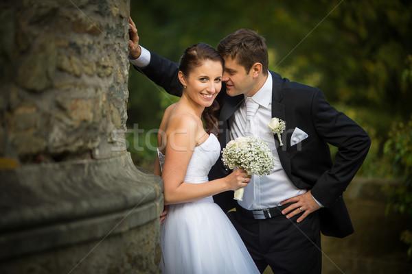 Beautiful, happy, younf wedding couple in a splendid historic ca Stock photo © lightpoet