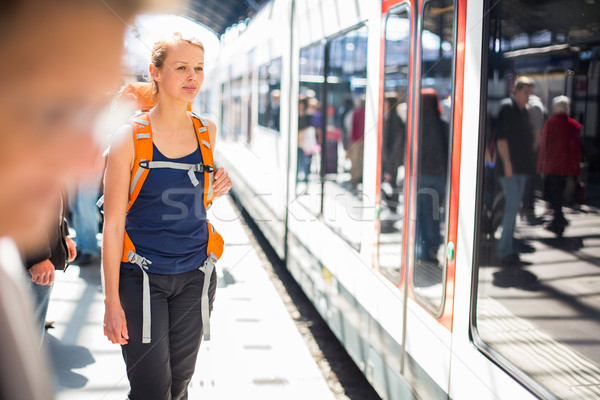 Pretty, young woman in a trainstation, waiting for her train Stock photo © lightpoet