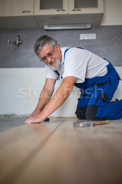 Male lying parquet floor board/laminate flooring Stock photo © lightpoet