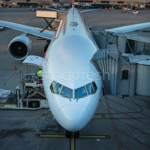 Aircraft with passage corridor/tunnel being prepared for departure Stock photo © lightpoet