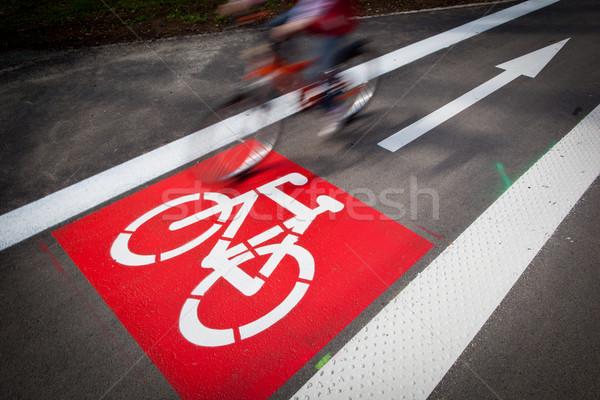 Urban traffic concept - bike/cycling lane sign in a city  Stock photo © lightpoet