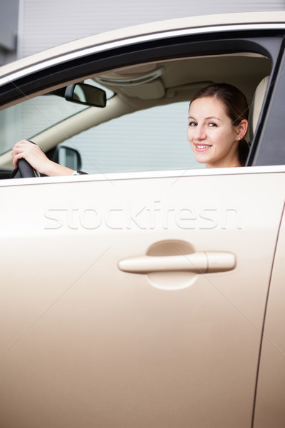 Pretty young woman driving her new car Stock photo © lightpoet